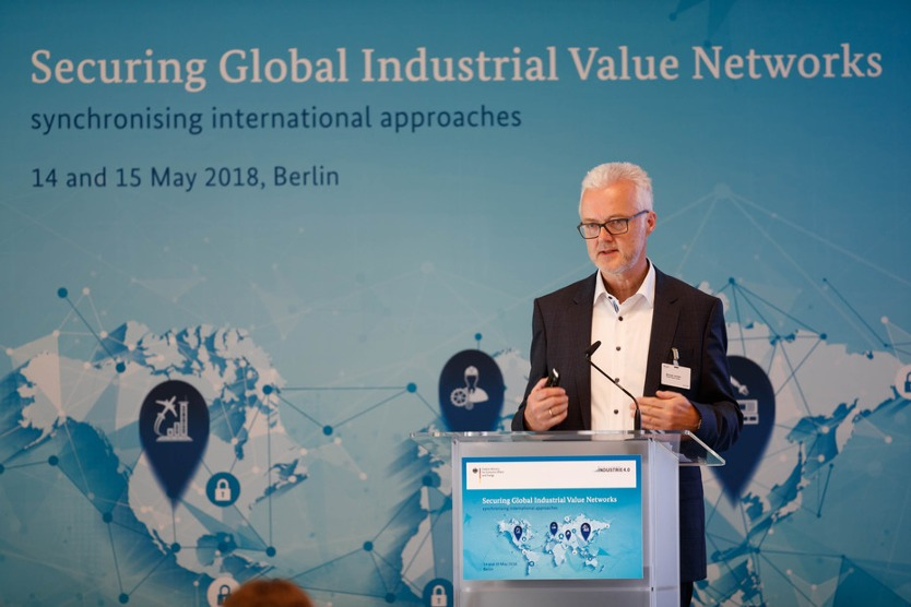 "Michael Jochem, Head of the Working Group ""Security of Networked Systems"" at the conference ""Securing Global Industrial Value Networks - Synchronizing International Approaches"" in 2018 in Berlin"